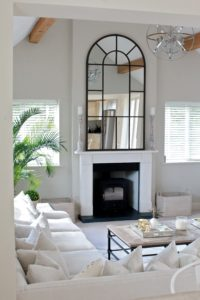 living room with arch mirror