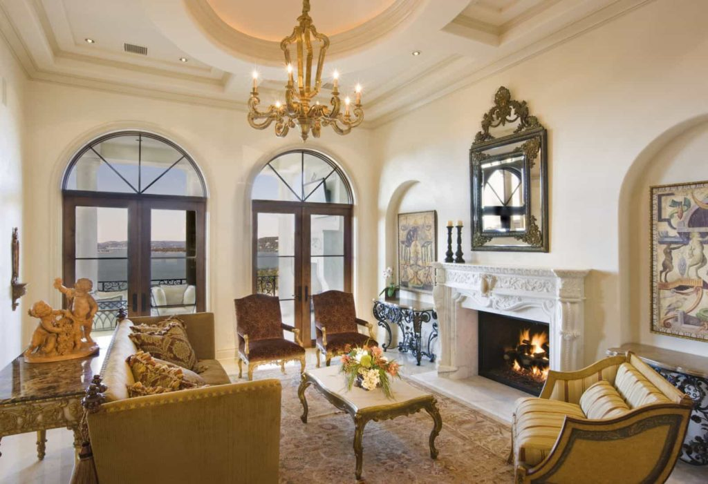 living-room-with-wall-mirror-over-fireplace-and-elegant-furniture