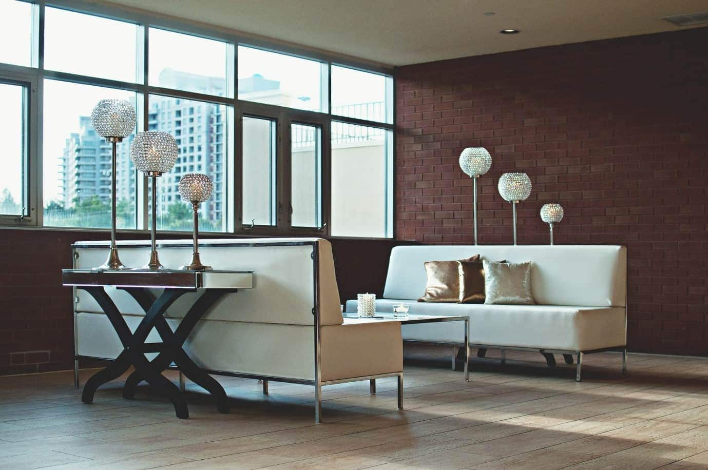 A bright living room with some interesting lamps.