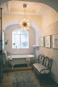 Placing a chandelier in a bathroom adds a touch of luxury