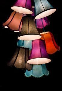 different colored chandelier heads put together with a dark background behind them