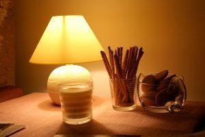 A table lamp snacks and cookies on a table