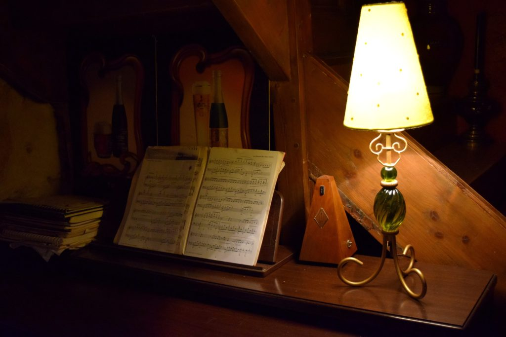 A lamp sitting on a piano