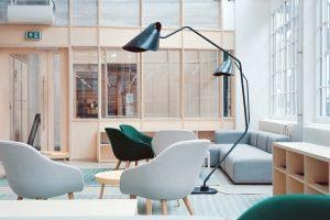 white and green chairs and two black floor lamps